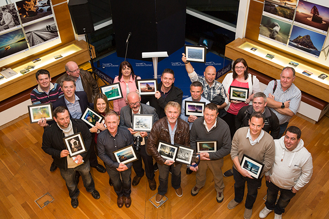 No Repro Fee 16-10-2015 Picture shows Pat Carey (foreground,centre,with trophy)winner of Clean Coasts 'Love Your Coast' Photographer of the Year 2015, awarded for his breathtaking shots of Dublin's stunning coastline,along with other winners at the Clean Coasts 'Love Your Coast' Awards ceremony, Waterway Ireland Visitor Centre, Grand Canal Dock, Dublin 2. See cleancoasts.org Pic:Paul Sharp-no fee